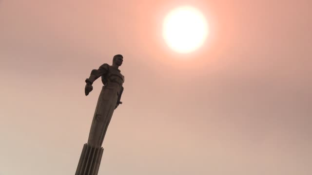 The golden sun shines down on the Yuri Gagarin Statue in Moscow, Russia. Available in HD.