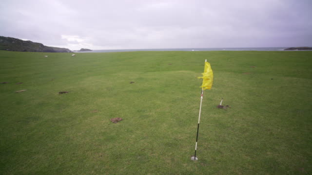 the golf course on the island of iona, scotland. - green golf course stock videos & royalty-free footage