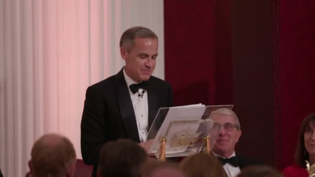 the governor of the bank of england mark carney gives a speech at mansion house in london after greenpeace protesters gatecrashed the dinner. - demonstrant stock-videos und b-roll-filmmaterial