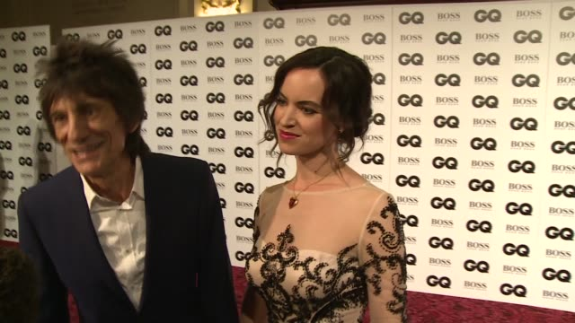 ronnie wood and wife along to speak to press / ronan keating and wife storm uechtritz posing on red carpet / ronnie wood and wife chatting to press /... - ronan keating stock videos & royalty-free footage