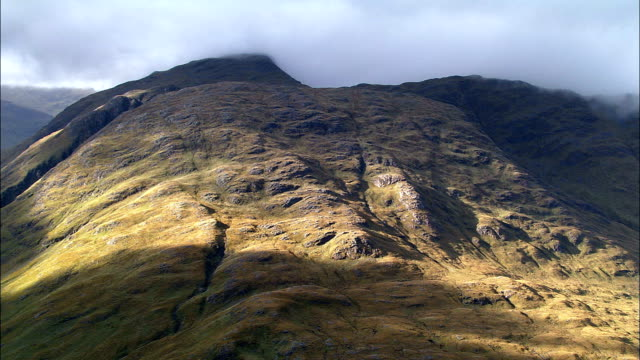 the grampian mountains around tyndrum  - aerial view - scotland, stirling, united kingdom - crag stock videos and b-roll footage