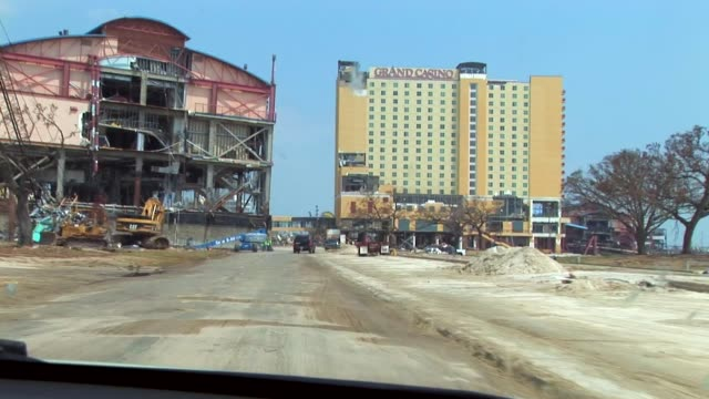 the grand casino beach front hotel in biloxi mississippi was severely damaged by hurricane katrina / the structure on the left was attached to the... - hurricane katrina stock videos and b-roll footage