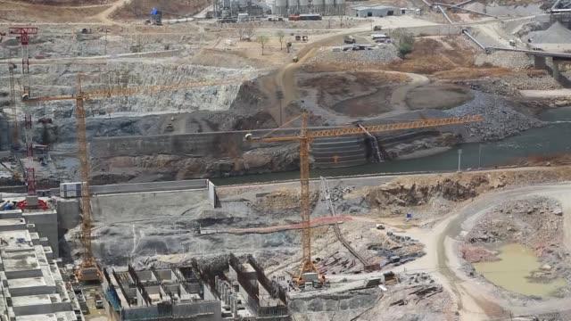 the grand ethiopian renaissance dam construction continues over blue nile river in guba district of the benishangulgumuz region of ethiopia on april... - corno d'africa video stock e b–roll