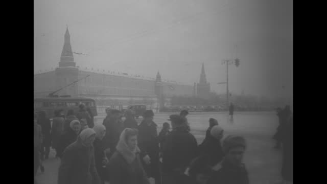 ws ext the grand kremlin palace as seen from across the moskva river / moscow street scene outside the kremlin wall on snowy windy day / ext hotel... - former ussr flag stock videos & royalty-free footage