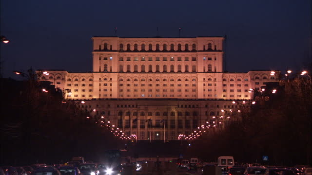 the grand palace of parliament is illuminated by floodlights in the city of bucharest. available in hd - romania stock videos & royalty-free footage