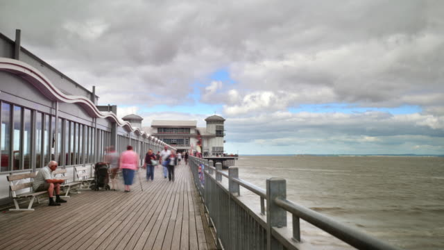 the grand pier at weston-super-mare visitors move up and down the piers promenade - 2013 stock videos & royalty-free footage