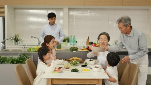 vídeos y material grabado en eventos de stock de the grandfather brings out food for their family - coreano oriental