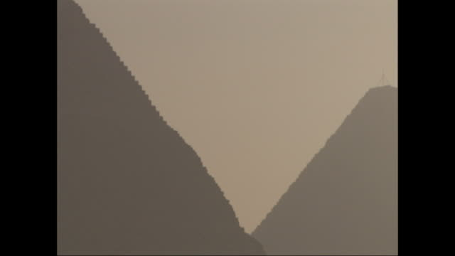the great pyramids silhouette against a smoggy sky. - place concerning death stock videos and b-roll footage