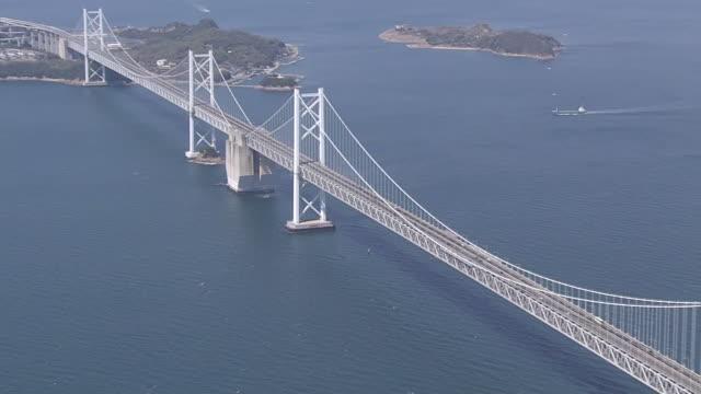 vídeos de stock e filmes b-roll de aerial, the great seto bridge, kagawa, japan - cable