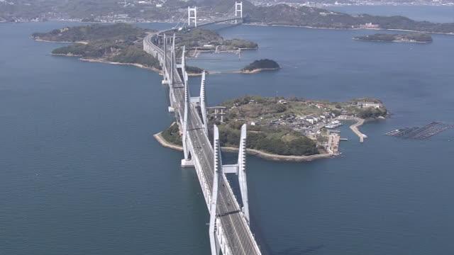 aerial, the great seto bridge, kagawa, japan - 最大点の映像素材/bロール