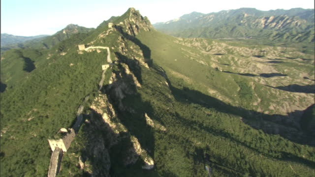 the great wall of china snakes across rugged mountain ridges. - great wall of china stock videos & royalty-free footage