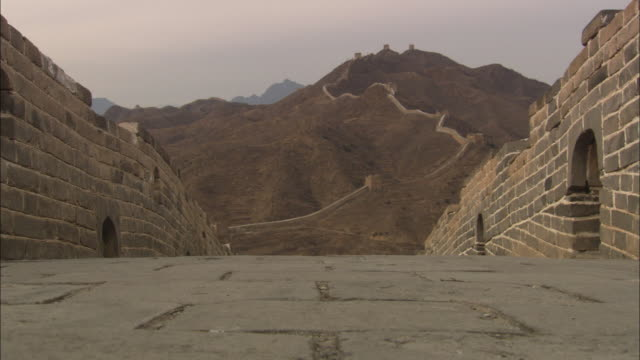 the great wall of china snakes up a mountain. - great wall of china stock videos & royalty-free footage