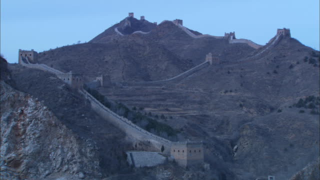 the great wall of china stretches along a mountain ridge. - great wall of china stock videos & royalty-free footage