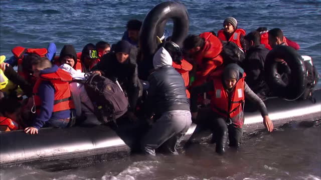 vídeos de stock e filmes b-roll de the greek coast guard is searching for eight people missing after a wooden boat carrying refugees collided with a patrol vessel off lesbos.... - 2015