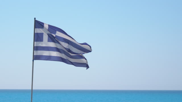 the greek flag flies in the wind - greek flag stock videos & royalty-free footage