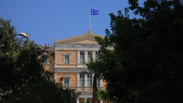 the greek flag waves above the hellenic parliament building near the syntagma square on august 23 2020 in athens greece during the coronavirus... - greek flag stock videos & royalty-free footage