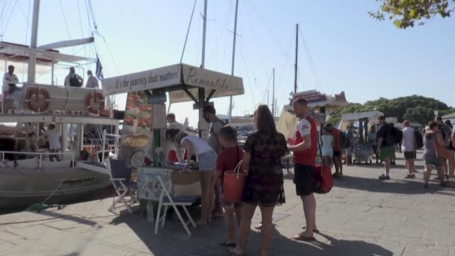 the greek island of rhodes continues to be a holiday hotspot for brits with holiday makers seemingly unconcerned that the country may be added to the... - tourism stock videos & royalty-free footage