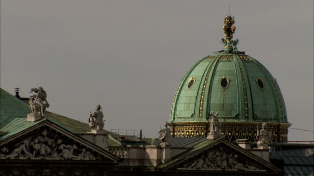 the green copper dome of the hofburg palace dominates the vienna skyline. available in hd. - dome stock videos & royalty-free footage