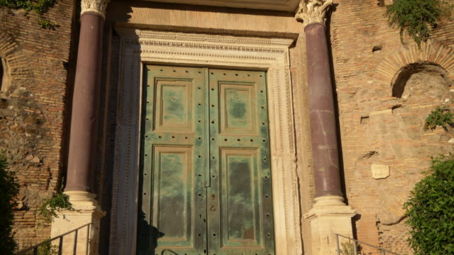 The green door of the Temple Romulus at the Roman Forum in Rome, Italy