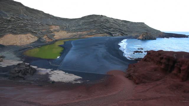 la laguna de los ciclos green lake, lanzarote, canary islands - bay of water stock videos & royalty-free footage
