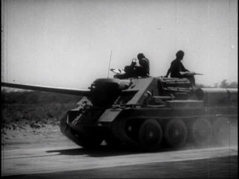 the ground battle commences and cuban tanks and troops are mobilized and join the fight / wounded soldiers are carried on stretchers - cuban culture stock videos & royalty-free footage
