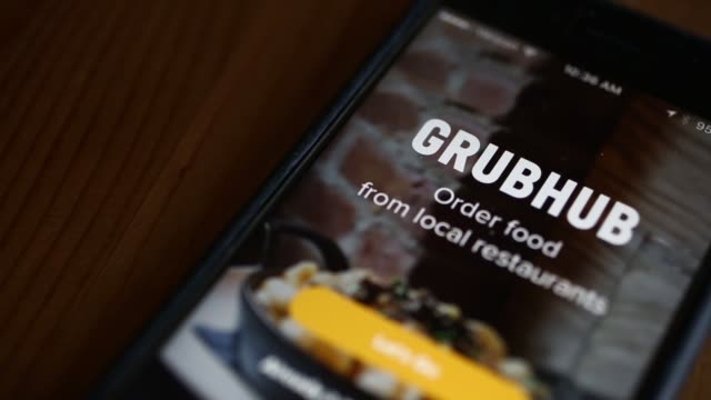 The GrubHub application is demonstrated on an Apple Inc iPhone in Washington DC US on Monday Feb 6 2017 Shots CU panning and tilting shots of Grubhub...