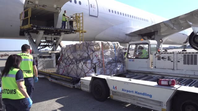 the guardia di finanza inspect medical aid and ppe equipment arrived from china at malpensa airport on may 22 2020 in milan italy - finanza stock videos & royalty-free footage