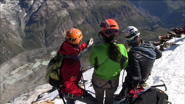 The guide and the climbers At the Summit Of the Matterhorn