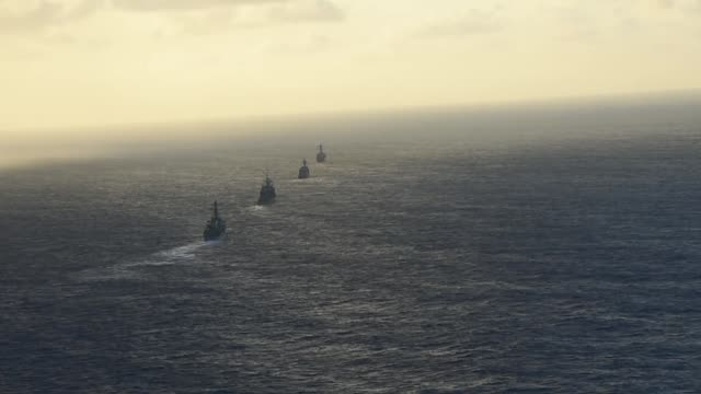 The guidedmissile destroyer USS Mustin leads the guidedmissile cruiser USS Antietam the guidedmissile destroyer USS Curtis Wilbur and the...