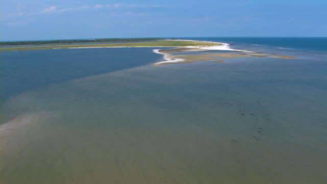 the gulf islands national seashore stretches toward the horizon. - gulf of mexico stock videos & royalty-free footage