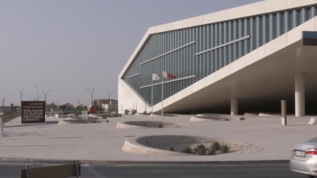 the gulf's largest book collection qatar's national library is one year old and has enhanced ties with libraries outside the region as the anti doha... - library stock videos & royalty-free footage