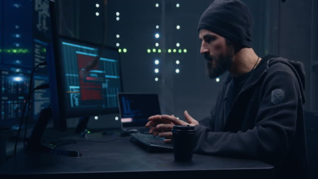 the hacker writes the program code, and at some point the program throws an error. the programmer is very angry, he angrily hits a paper cup of coffee that falls off the table. - computer hacker stock videos & royalty-free footage