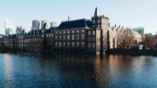 the hague's binnenhof with the hofvijver - dutch politics building - binnenhof stock videos and b-roll footage