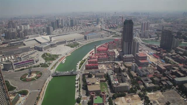 the hai river flows through tianjin, china. - hai river stock videos & royalty-free footage