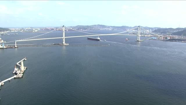 the hakucho ohashi bridge spans the muroran port in hokkaido, japan. - 1996 stock videos and b-roll footage