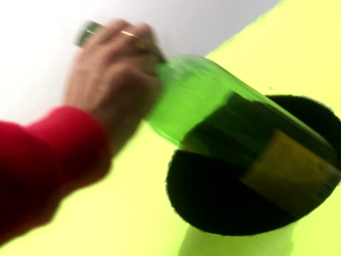 the hand of a man putting a bottle in a recycling plant sweden. - only mid adult men stock videos & royalty-free footage