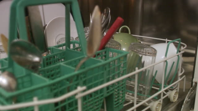 the hand of a man taking out the dishes from the dishwasher. - spülmaschine stock-videos und b-roll-filmmaterial