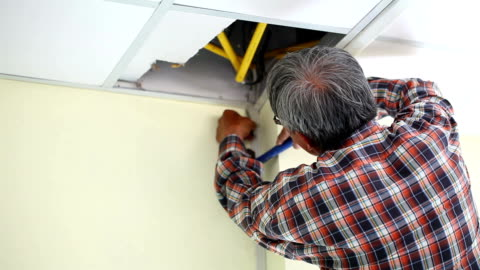 stockvideo's en b-roll-footage met the hands of an electrician installing a power socket - rubriekadvertentie