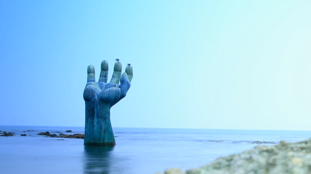 stockvideo's en b-roll-footage met the hands of harmony sculpture on the homigot sunrise square (famous sunrise spot) in pohang, south korea - handpalm