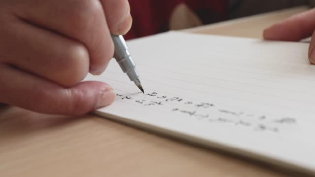 the hands of the senior woman writing a letter. - message stock videos & royalty-free footage