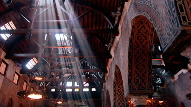 the hanging church view of shafts of light illuminating the interior of cairo's most famous coptic church with its ancient barrelvaulted ceiling - light beam stock videos & royalty-free footage