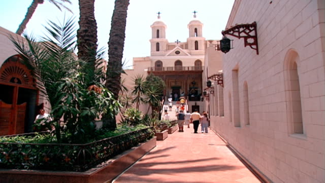 the hanging church. view of the entrance of cairo's most famous coptic church. the hanging church or al-muallaqa in arabic was built above the... - architecture stock videos & royalty-free footage
