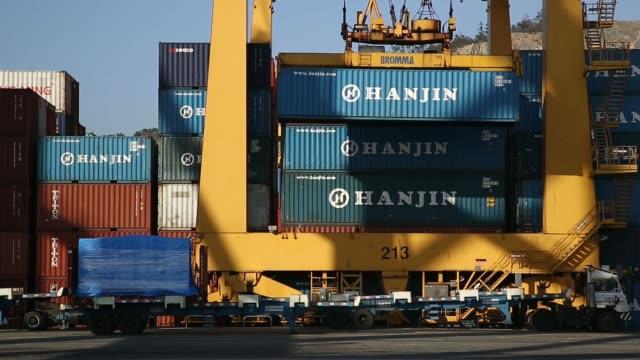 The Hanjin Hamburg cargo ship sits berthed at the Hanjin Shipping Co Busan New Port terminal in Busan South Korea on Tuesday Dec 10 A gantry crane...