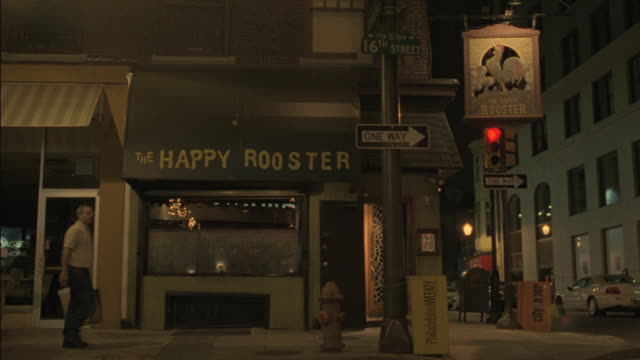 the happy rooster bar stands on a corner in philadelphia. - philadelphia pennsylvania stock videos & royalty-free footage