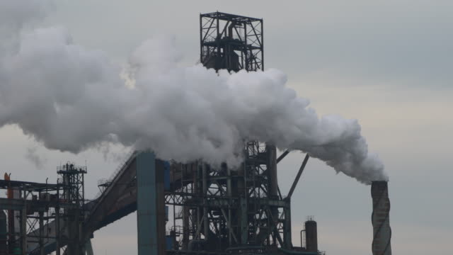 stockvideo's en b-roll-footage met the harbor belongs to shenhua group which is the largest and most modern coal enterprise in china engaged in coalbased power generation railway and... - schoorsteen