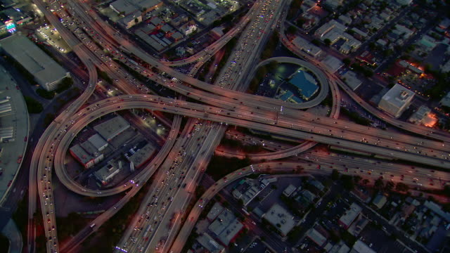 The Harbor Freeway (Interstate 110) and the Santa Monica Freeway (Interstate 10) intersect in a partial cloverleaf stack interchange in Los Angeles.