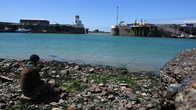 the harbor on the island of jersey, united kingdom on saturday, may 8, 2021 following protests by french fishing vessels over fishing rights. - 男漁師点の映像素材/bロール