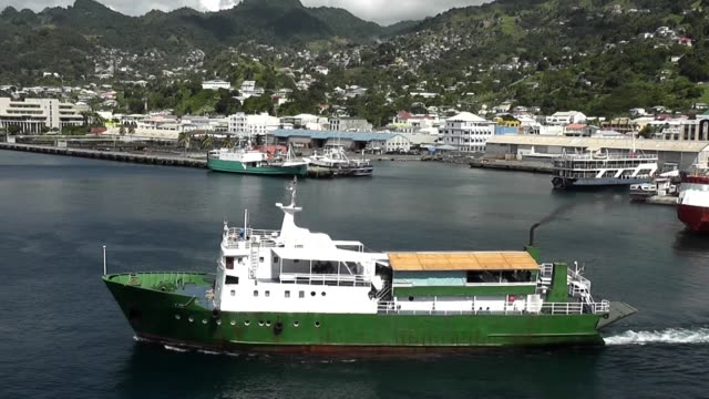 the harbour in st vincent west indies with ship passing in front of shot - west indies stock videos and b-roll footage