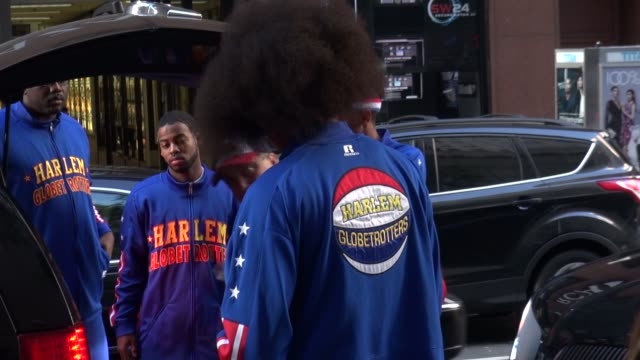 the harlem globetrotters arrive at the today show in rockefeller center in new york city at celebrity sightings in new york, - ハーレムグローブトロッターズ点の映像素材/bロール