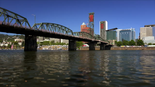 The Hawthorne Bridge crosses over the Willamette River and leads into Portland, Oregon